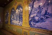 Azulejo is a Portuguese glazed ceramic tile.   In Portugal and other former Portuguese colonies azulejos are found in palaces, churches, homes, schools, and even restaurants.  Azuelo often highlight  historical points in Portuguese culture.