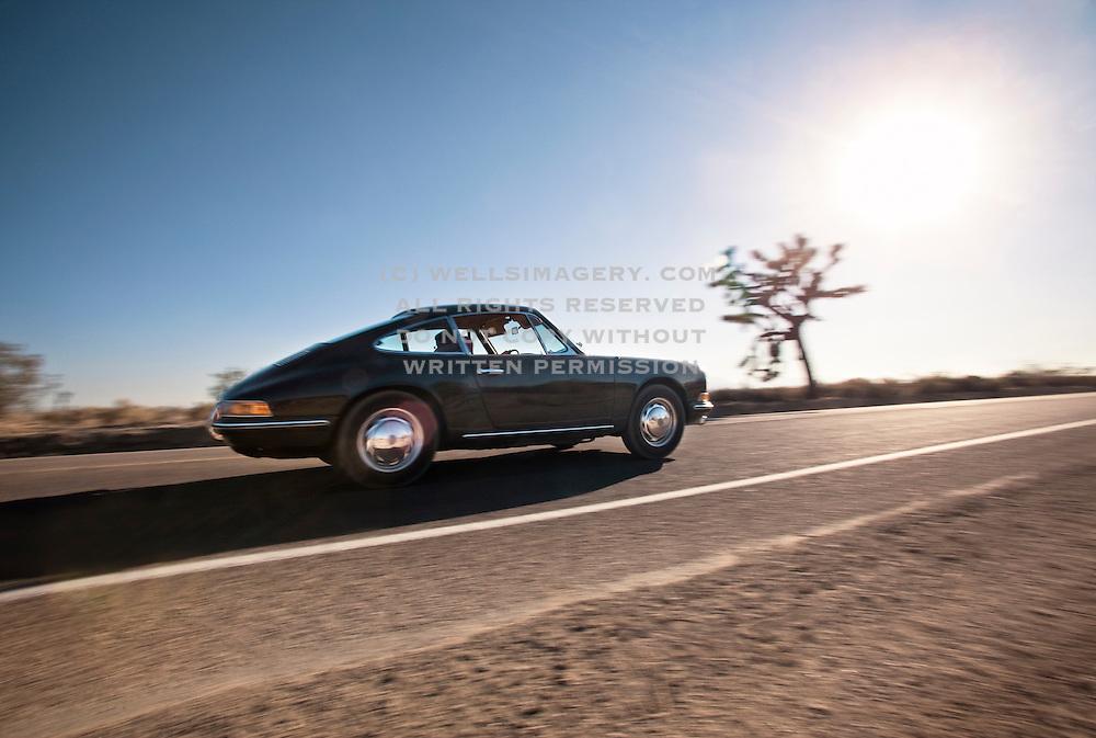 Slate gray 1966 Porsche in the Mojave Desert, California, American west coast by Randy Wells