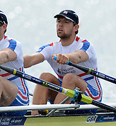 Trackai. LITHUANIA. GBR BM2X, Bow.  Jack BEAUMONT,  start morning heat, men's double sculls on Lake Galve.  2012 FISA U23 World Rowing Championships,   10:40:04  Friday  13/07/2012 [Mandatory Credit: Peter Spurrier/Intersport Images]..Rowing. 2012. U23.