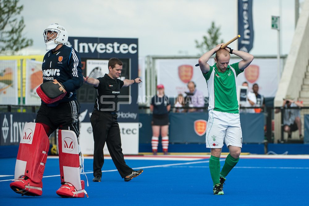 Ireland's Eugene Magee holds his head in his hands after having his penalty saved by George Pinner of England during their shoot-out. Final of the Investec London Cup, Lee Valley Hockey & Tennis Centre, London, UK on 13 July 2014. Photo: Simon Parker