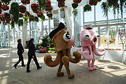 Members of staff walk by animated octopi, perhaps modeled from the pirates of the Caribbean, in Rizhao Ocean Park, Marina, during opening ceremonies, Shandong Province, China