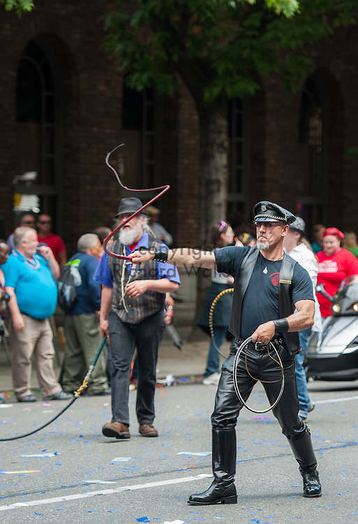 2014 June 29 - A man with a whip in the 2014 Pride Parade, Seattle, WA. By Richard Walker