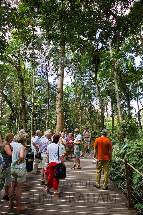 Tourists on boardwalk tour in Barron Gorge National Park, North Queensland, Australia