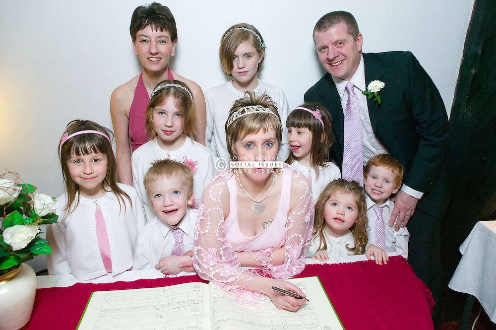 Just Married; bride; with her groom; bridesmaids and pageboys; signs the marriage register,