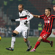 Gaziantepspor's Gokhan Suzen (R) and Besiktas's Serdar Kurtulus (L) during their Turkish superleague soccer match Gaziantepspor between Besiktas at the Kamil Ocak stadium in Gaziantep Turkey on Sunday 14 December 2014. Photo by Kurtulus YILMAZ/TURKPIX