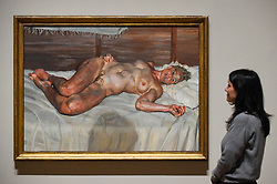 """© Licensed to London News Pictures. 23/10/2019. LONDON, UK. A staff member views """"Flora with Blue Toenails"""", 2000-01, by Lucien Freud. Preview of """"Lucian Freud: The Self-portraits"""" at the Royal Academy of Arts in Piccadilly.  56 works on display chart Freud's artistic development over almost seven decades on canvas and paper in a show which runs 27 October to 26 January 2020.  Photo credit: Stephen Chung/LNP"""