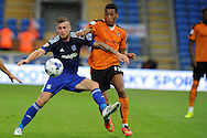 Joe Ralls of Cardiff city (l)  holds off Rajiv Van La Parra of Wolverhampton Wanderers.  Skybet football league championship match, Cardiff city v Wolverhampton Wanderers at the Cardiff city stadium in Cardiff, South Wales on Saturday 22nd August 2015.<br /> pic by Andrew Orchard, Andrew Orchard sports photography.