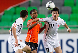 Djavan Anderson of Netherlands between Vano Tsilosani of Georgia and Dato Dartsimelia of Georgia during the UEFA European Under-17 Championship Semifinal match between Netherlands and Georgia on May 13, 2012 in SRC Stozice, Ljubljana, Slovenia. (Photo by Vid Ponikvar / Sportida.com)