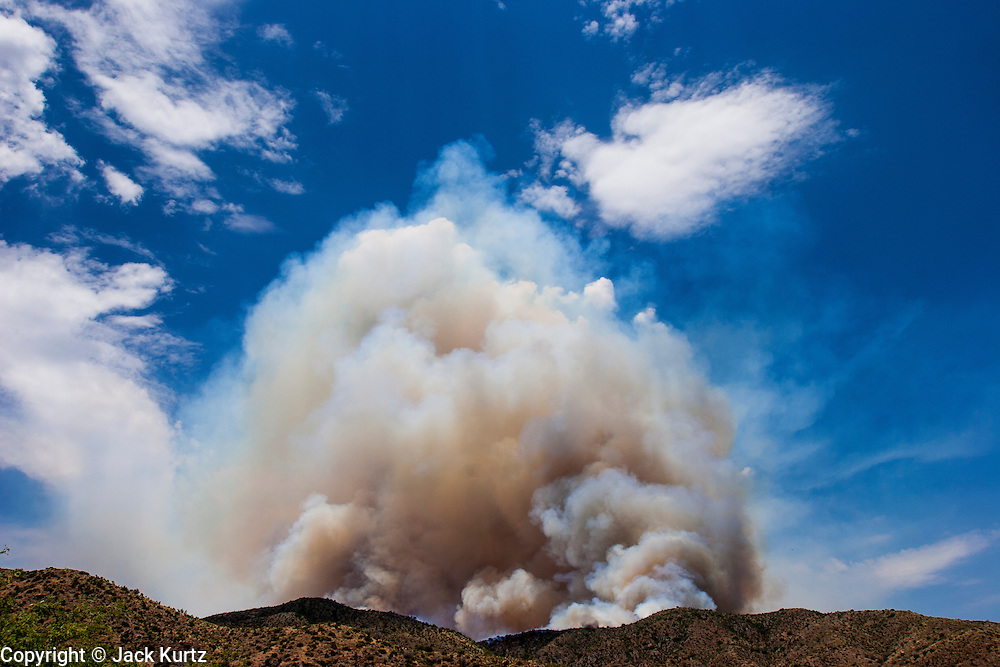 22 JUNE 2005 - CAVE CREEK, AZ:   Smoke billows up from the Cave Creek Complex, a large wild fire which burned northeast of Phoenix. The Cave Creek Complex fire was the third largest wildfire in the state of Arizona to date, after the Rodeo-Chediski fire and Wallow Fire. The fire started on June 21, 2005 by a lightning strike during a monsoon storm and burned 243,950 acres (987.2 km2).   PHOTO BY JACK KURTZ