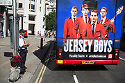 Summertime in London, England, UK. London tour Bus advertising the hit West End musical Jersey Boys. Jersey Boys is a jukebox musical that dramatises the formation, success and eventual break-up of the 1960s rock 'n roll group The Four Seasons.