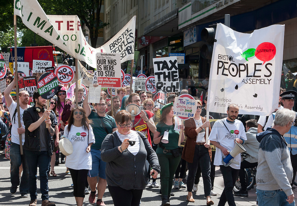 © Licensed to London News Pictures. 30/05/2015. Bristol, UK.  Anti cuts and anti austerity march in Bristol city centre organised by the People's Assembly protesting against the new Conservative Government's plans for public sector cuts.  Photo credit : Simon Chapman/LNP