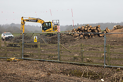 Wendover, UK. 18th March, 2021. Piles of logs and branches from woodland felled by HS2 contractors alongside Small Dean Lane are pictured in a HS2 compound. Considerable preparatory work of this type is currently taking place along a section of the HS2 high-speed rail link route between Great Missenden and Wendover which lies to the north of the Chiltern tunnel section of the £106bn rail link.