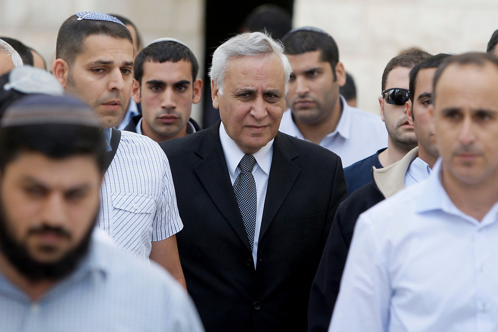 Former Israeli President Moshe Katsav (C), leaves Israel's Supreme Court in Jerusalem on November 10, 2011, after  hearing the verdict of his appeal on rape and other sexual offences conviction. The Supreme Court rejected all of the Former President's defenses and ruled that Katsav's rape conviction and sever-year prison sentence stand, rendering Katsav the first president in Israel's history to be sent to prison.