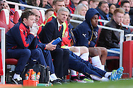 Arsene Wenger, the Arsenal manager looks on concerned from the dugout. Barclays Premier league match, Arsenal v Crystal Palace at the Emirates Stadium in London on Sunday 17th April 2016.<br /> pic by John Patrick Fletcher, Andrew Orchard sports photography.