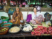 14 JUNE 2013 -  PANTANAW, AYEYARWADY, MYANMAR: Market vendors in the market in Pantanaw, in the Ayeyarwady Region of south-west Myanmar. It is the hometown of former United Nations Secretary-General U Thant and of the renowned artist U Ba Nyan.   PHOTO BY JACK KURTZ