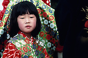 A young Japanese girl is dressed as a Geisha.