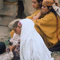 Kashmiri village girls watch a cavalcade of Hindu pilgrims en route to Amarnath Cave in the Great Himalaya Range of Kashmir, India.