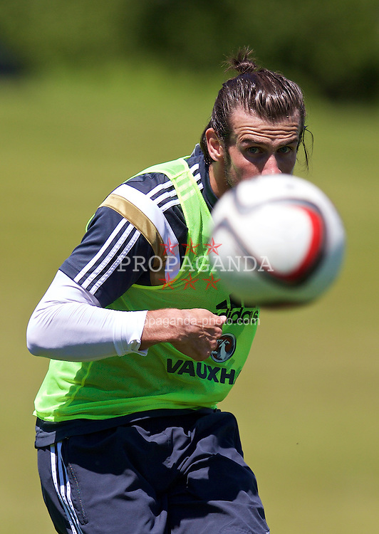 CARDIFF, WALES - Wednesday, June 3, 2015: Wales' Gareth Bale practices a free-kick during a training session at the Vale of Glamorgan ahead of the UEFA Euro 2016 Qualifying Round Group B match against Belgium. (Pic by David Rawcliffe/Propaganda)