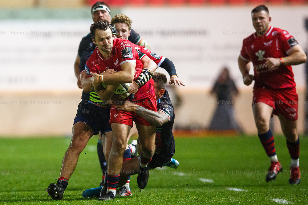 Llanelli, UK. 8 November, 2020.<br /> Scarlets centre Paul Asquith is tackled during the Scarlets v Zebre PRO14 Rugby Match.<br /> Credit: Gruffydd Thomas/Alamy Live News