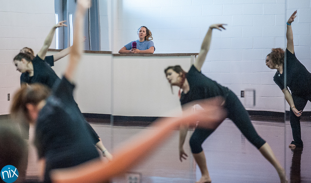 Cox Mill dance teacher Liz Crawford works with her class Friday afternoon