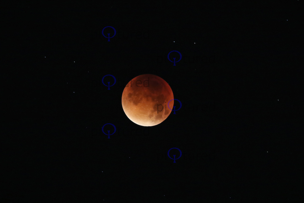 Supermoon Lunar Eclipse. A rare celestial event that has not occurred for 30 years. A lunar eclipse, when the moon is covered by the Earth's shadow, with the moon near to its closest point to the Earth. During a lunar eclipse, the moon turns a deep rusty red, due to sunlight being scattered by the Earth's atmosphere.