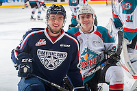 KELOWNA, CANADA - MARCH 4: Brothers Kyle Topping #24 of the Kelowna Rockets and Jordan Topping #12 of the Tri-City Americans kneel at centre ice during warm up on March 4, 2017 at Prospera Place in Kelowna, British Columbia, Canada.  (Photo by Marissa Baecker/Shoot the Breeze)  *** Local Caption ***