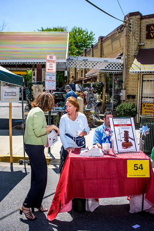 """Kensington, Maryland - April 24, 2016: Ruthann Aron Green markets her book """"Corrupted Justice -- A Killer Husband,"""" to Carolyn Thompson during the Kensington Book Festival in Kensington, Md., Sunday April 24, 2016. <br /> <br /> Former U.S. Senate candidate, lawyer and developer Ruthann Aron Green attempts to sell her autobiography """"Corrupted Justice -- A Killer Husband,"""" at the Kensington Book Festival in Kensington, Md., Sunday April 24, 2016. <br /> <br /> In 1997 Aron Green was recorded by an undercover police officer, posing as a hit-man, soliciting the murder of her husband, a wealthy urologist, and another man. After a high-profile arrest, a mistrial, and a second court cases ending in a no-contest plea, she was jailed from 1997 to 2000 at the Montgomery County Detention Center. She blames her mental state on an abusive relationship with Barry Aron, her husband. """"I had a psychotic break resulting from 30 years of abuse and over drugging of prescription drugs by my husband."""" <br /> <br /> After years away from Montgomery County, she's returned with a self-published autobiography as part of her campaign to re open her case and attempt to clear her name. If the case doesn't go her way, she opens herself up to be convicted for attempted murder.<br /> CREDIT: Matt Roth"""
