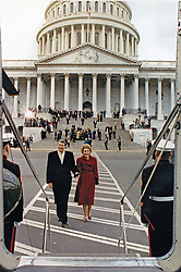 """Former United States President Ronald Reagan and former first lady Nancy Reagan leave the US Capitol in Washington, DC after the inaugural ceremonies on January 20, 1989. They boarded Nighthawk 1 for a ride to Andrews Air Force Base and the subsequent flight home to California. A Marine helicopter which has the sitting President aboard uses the call sign """"Marine One."""" In this case, since Mr. Reagan was no longer the sitting President the helicopter was known by the call sign """"Nighthawk 1"""" for the Marine Helicopter Squadron One (HMX-1), nicknamed the """"Nighthawks."""" Photo by Pete Souza / White House via CNP /ABACAPRESS.COM"""