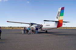 Airplane for daytrip from Las Vegas, Nevada, NV, to Grand Canyon, Arizona, AZ, passengers on tarmac, No model release, Image nv445-18532.Photo copyright: Lee Foster, www.fostertravel.com, lee@fostertravel.com, 510-549-2202