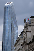 Seen from the City of London, One Blackfriars (one of the capital's newest skyscrapers) rises above a Union jack flag, on 22nd June 2021, in London, England. Located on Bankside, the south bank of the river Thames, the development is a 52-storey 170m tower whose uses include residential flats, a hotel and retail.
