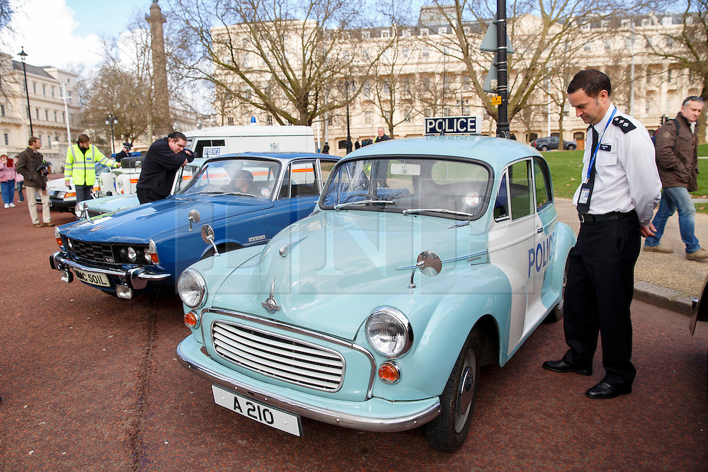 © licensed to London News Pictures. London, UK 26/02/2014. The Met's iconic cop cars dating back to 1948 taking part at a convoy through central London as vehicles including the 1948 Wolseley, 1970 Morris, Minor 1000 and the 1973 Special Branch Rover P6 leaving Hampton Traffic Garage for the final time to head up to the Met's Peel Centre in Hendon which will be the new home of the fleet. Photo credit: Tolga Akmen/LNP