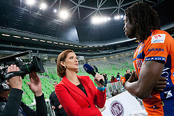 Journalist of TV Slovenija Marjeta Hocevar and Mory Sidibe of ACH after the volleyball match between ACH Volley Ljubljana and Bre Banca Lannutti Cuneo (ITA) in Playoff 12 game of CEV Champions League 2012/13 on January 15, 2013 in Arena Stozice, Ljubljana, Slovenia. (Photo By Vid Ponikvar / Sportida.com)