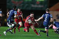 Wyn Jones of the Scarlets looks to go past Quinn Roux (l) and Tom McCartney of Connacht ® . Guinness Pro12 rugby match, Scarlets  v Connacht at the Parc y Scarlets in Llanelli, West Wales on Saturday 24th September 2016.<br /> pic by  Andrew Orchard, Andrew Orchard sports photography.