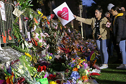 March 17, 2019 - Christchurch, Canterbury, New Zealand - A woman seen hanging a placard while paying respect to the victims of the Christchurch mosques shooting. Around 50 people has been reportedly killed a terrorist attack onn two Christchurch mosques. (Credit Image: © Adam Bradley/SOPA Images via ZUMA Wire)