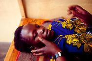 Sudan, May 2009.  Nurse Betty Ajio Buku checks Susan Aya for problems in her pregnancy at the Saint Bakhita Health Centre in Yei.