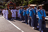 Shinto Priests at Mengake Procession - Mengake or Masked Parade at Goryo Jinja shrine.  At this festival held in September a group of ten people take part in this annual ritual: 8 men and 2 women. Wearing comical or grotesque masks that signify different demons, legends and dieties  leave the shrine and parade through the nearby streets accompanied by portable shrine and festival music.