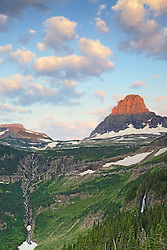 The kiss of morning light touches Mt. Clemens at Reynolds Pass in Glacier National Park