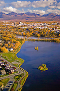 Alaska. Anchorage. Aerials. Anchorage is located at the base of the Chugach Mountains, lined by the Cook Inlet. Turnagain Arm begins at the southern end of Anchorage. Autumn coloring with downtown cityscapes. Westchester Lagoon and midtown neighborhoods.