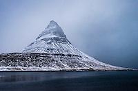 GRUNDARFJOROUR, ICELAND - CIRCA MARCH 2015: Kirkjufell mountain near Grundarfjordur, a landmark in the Snaefellsness Peninsula.