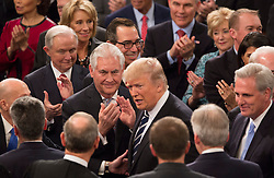 United States President Donald J. Trump is greeted by members of his Cabinet before addressing a joint session of Congress on Capitol Hill in Washington, DC, USA, February 28, 2017. Photo by Chris Kleponis/CNP/ABACAPRESS.COM