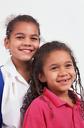 Portrait of two young girls smiling,