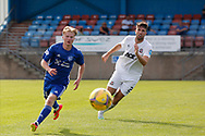 Peterhead's Lyle Cameron (10) and Cove Rangers' Morgyn Neill (2) battles for possession, tussles, tackles, challenges, during the Premier Sports Scottish League Cup match between Peterhead and Cove Rangers at Balmoor, Peterhead, Scotland on 17 July 2021.