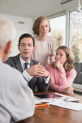 Consultant and family talking at home