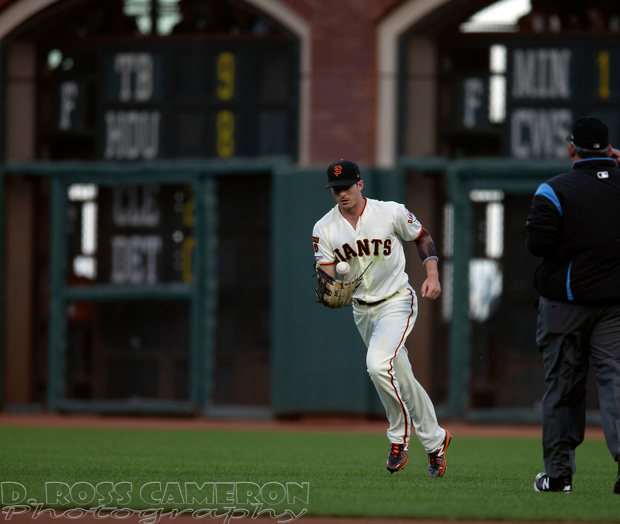 San Francisco Giants left fielder Mike Yastrzemski flips the ball after making an acrobatic catch during the second inning of a baseball game against the San Diego Padres, Thursday, Aug. 29, 2019, in San Francisco. (AP Photo/D. Ross Cameron)
