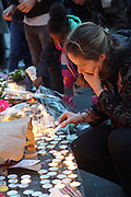Lighting Candles. Place Republique, Parisians pay hommage to those killed and wounded in the Terrorist attacks<br />