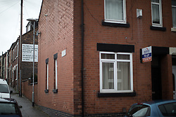 "© Licensed to London News Pictures . 16/02/2017. Stoke-on-Trent, UK. A neighbour of 65 Oxford Street , which was the registered address of Paul Nuttall in Stoke , erects a large banner on the side of their house with a quote from Nuttall that reads "" The NHS is a monolith hangover from days gone by "" and a statement beneath saying "" Mr Nuttall can't be trusted to protect the NHS "" . 65 Oxford Street now has a "" TO LET "" board fixed to the front . Photo credit: Joel Goodman/LNP"