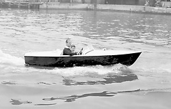 File photo dated 07/08/57 of Prince Charles with his father the Duke of Edinburgh at the wheel, as they take a motor boat ride up the River Medina at Cowes, Isle of Wight.