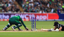 New Zealand's Colin de Grandhomme is run out during the ICC Cricket World Cup group stage match at Edgbaston, Birmingham.