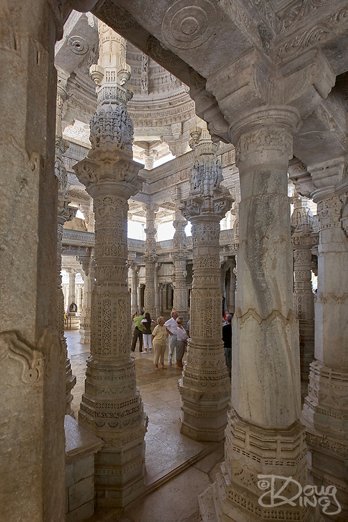 Tourists admire the magnificent architecture of the Jain Temple at Ranakpur in the municipality of Udaipur Rajasthan India