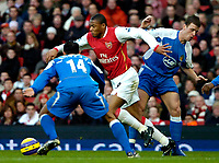 Photo: Ed Godden/Sportsbeat Images.<br /> Arsenal v Wigan Athletic. The Barclays Premiership. 11/02/2007. Arsenal's Julio Baptista (centre), makes his way through the Wigan players.